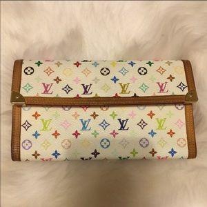 Louis Vuitton Porte trifold international wallet